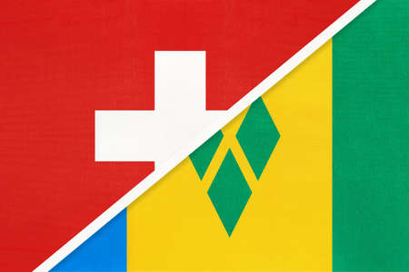 Switzerland or Swiss Confederation and Saint Vincent and the Grenadines, symbol of national flags from textile. Relationship, partnership and championship between European and American countries.