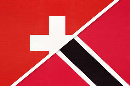 Switzerland or Swiss Confederation and Trinidad and Tobago, symbol of national flags from textile. Relationship, partnership and championship between European and American countries. Archivio Fotografico