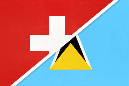 Switzerland or Swiss Confederation and Saint Lucia, symbol of national flags from textile. Relationship, partnership and championship between European and American countries.