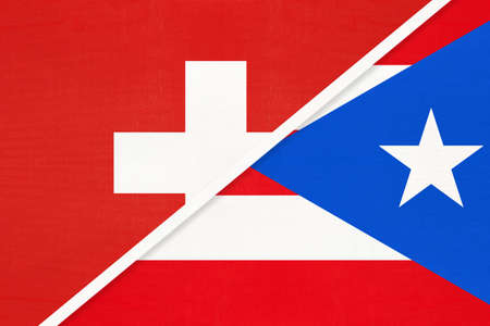 Switzerland or Swiss Confederation and Puerto Rico, symbol of national flags from textile. Relationship, partnership and championship between European and American countries.