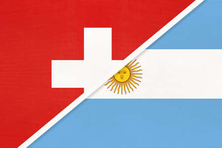Switzerland or Swiss Confederation and Argentina or Argentine Republic, symbol of national flags from textile. Relationship, partnership and championship between European and American countries.