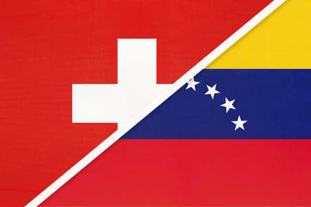 Switzerland or Swiss Confederation and Venezuela, symbol of national flags from textile. Relationship, partnership and championship between European and American countries. Archivio Fotografico