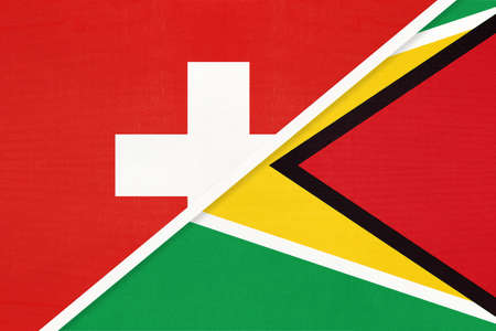 Switzerland or Swiss Confederation and Guyana, symbol of national flags from textile. Relationship, partnership and championship between European and American countries.