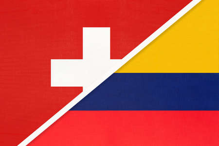 Switzerland or Swiss Confederation and Colombia, symbol of national flags from textile. Relationship, partnership and championship between European and American countries.