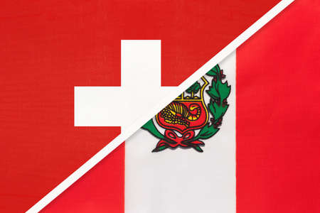 Switzerland or Swiss Confederation and Peru, symbol of national flags from textile. Relationship, partnership and championship between European and American countries.