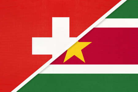 Switzerland or Swiss Confederation and Suriname, symbol of national flags from textile. Relationship, partnership and championship between European and American countries.