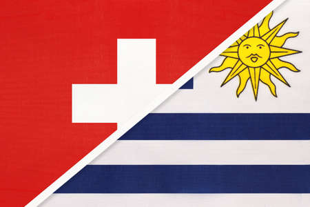 Switzerland or Swiss Confederation and Uruguay, symbol of national flags from textile. Relationship, partnership and championship between European and American countries.