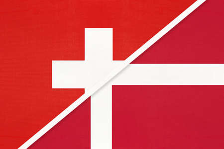 Switzerland or Swiss Confederation and Denmark, symbol of national flags from textile. Relationship, partnership and championship between two European countries.