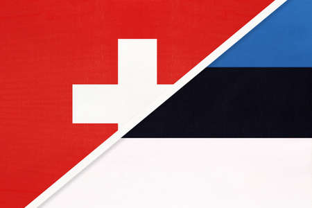 Switzerland or Swiss Confederation and Estonia, symbol of national flags from textile. Relationship, partnership and championship between two European countries.