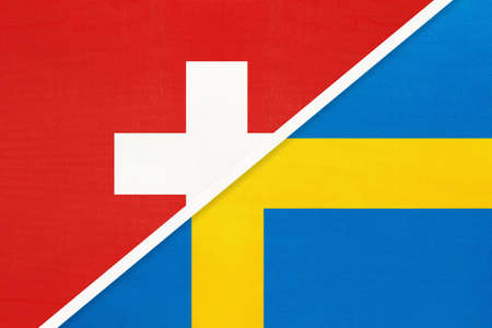 Switzerland or Swiss Confederation and Sweden, symbol of national flags from textile. Relationship, partnership and championship between two European countries.