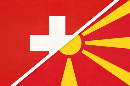 Switzerland or Swiss Confederation and North Macedonia, symbol of national flags from textile. Relationship, partnership and championship between two European countries.