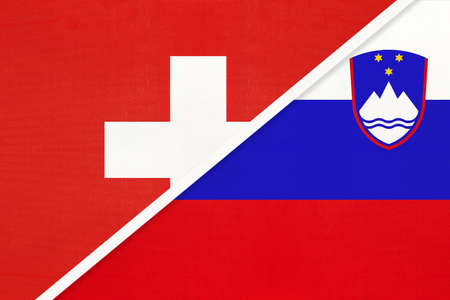 Switzerland or Swiss Confederation and Slovenia, symbol of national flags from textile. Relationship, partnership and championship between two European countries.
