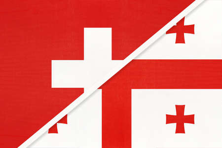 Switzerland or Swiss Confederation and Georgia, symbol of national flags from textile. Relationship, partnership and championship between European and Asian countries.