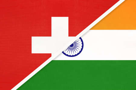 Switzerland or Swiss Confederation and India, symbol of national flags from textile. Relationship, partnership and championship between European and Asian countries.