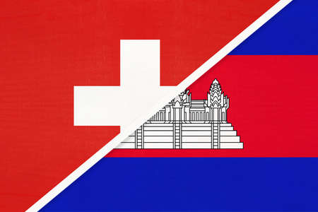 Switzerland or Swiss Confederation and Cambodia or Kampuchea, symbol of national flags from textile. Relationship, partnership and championship between European and Asian countries.