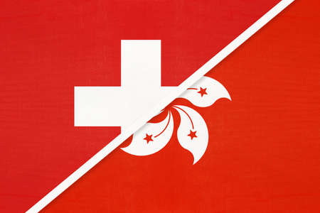 Switzerland or Swiss Confederation and Hong Kong, symbol of national flags from textile. Relationship, partnership and championship between European and Asian countries.