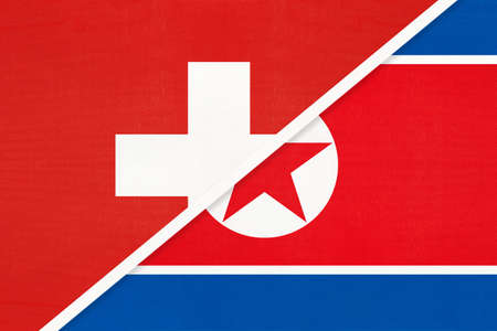 Switzerland or Swiss Confederation and North Korea or DPRK, symbol of national flags from textile. Relationship, partnership and championship between European and Asian countries.