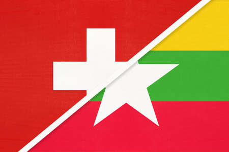 Switzerland or Swiss Confederation and Myanmar or Burma, symbol of national flags from textile. Relationship, partnership and championship between European and Asian countries.