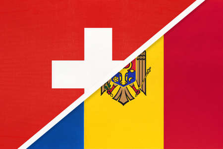 Switzerland or Swiss Confederation and Moldova, symbol of national flags from textile. Relationship, partnership and championship between two European countries.