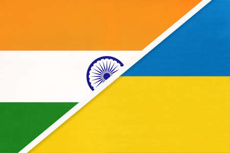India and Ukraine, symbol national flags from textile. Relationship, partnership and championship between two countries.