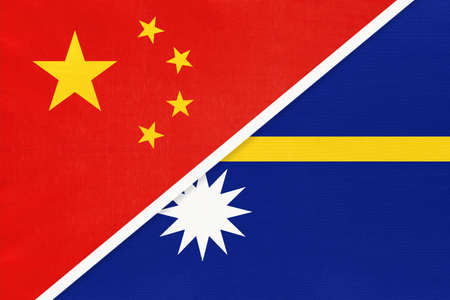 People's Republic of China or PRC vs Nauru national flag from textile. Relationship, partnership and economic between two Asian and Oceania countries.