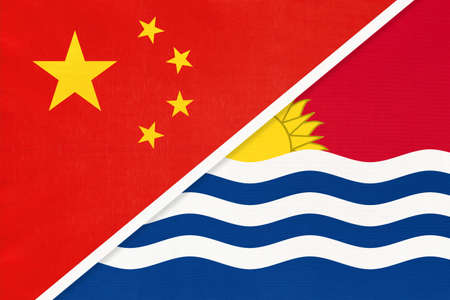 People's Republic of China or PRC vs Kiribati national flag from textile. Relationship, partnership and economic between two Asian and Oceania countries.