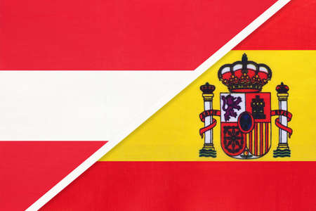 Austria and Spain, national flags from textile. Relationship, partnership and match between two countries.