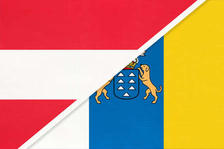 Austria and Canary Islands, national flags from textile. Relationship, partnership and match between two countries. 版權商用圖片