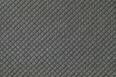 Texture of dark gray fluffy fabric background with rhomboid pattern, macro. Abstract backdrop from decorative black woven textile material. Standard-Bild