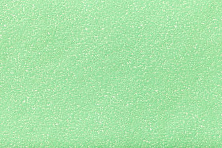 Texture of old light green paper closeup. Structure of a dense cardboard. The pastel cyan background. Stock Photo