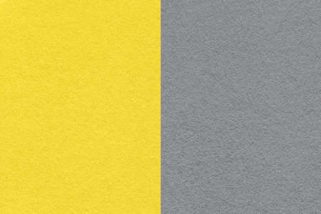 Trend color of the Year 2021 Illuminating yellow and Ultimate Gray. Texture of old neutral gray paper background, macro. Modern backdrop with geometric shape.
