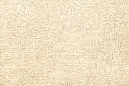Texture of light beige wallpaper with relief and corrugated pattern. Paper cream background with modern design. Surface closeup. Zdjęcie Seryjne