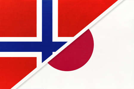 Norway and Japan, national flags from textile. Relationship, partnership and match between two countries.