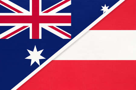 Australia and Austria, national flags from textile. Relationship, partnership and match between two countries.