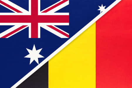 Australia and Belgium, national flags from textile. Relationship, partnership and match between two countries.
