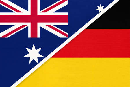 Australia and Germany, national flags from textile. Relationship, partnership and match between two countries.