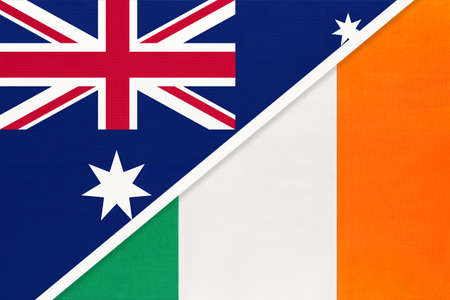 Australia and Ireland, national flags from textile. Relationship, partnership and match between two countries.