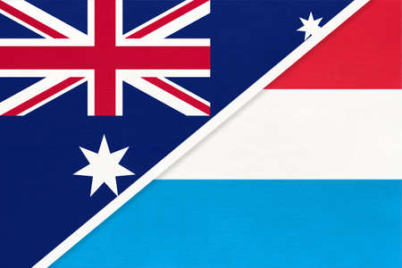 Australia and Luxembourg, national flags from textile. Relationship, partnership and match between two countries.