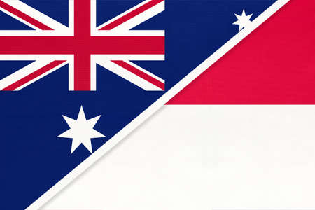 Australia and Monaco, national flags from textile. Relationship, partnership and match between two countries.