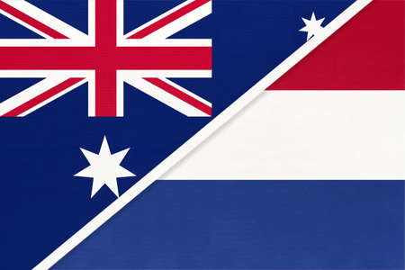 Australia and Netherlands or Holland, national flags from textile. Relationship, partnership and match between two countries.