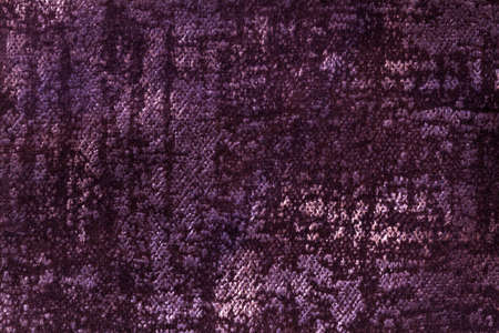 Dark purple and violet fluffy background of soft, fleecy fabric. Texture of wine textile backdrop with shiny pattern, closeup. Standard-Bild