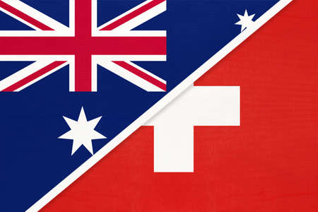 Australia and Switzerland or Swiss Confederation, national flags from textile. Relationship, partnership and match between two countries.