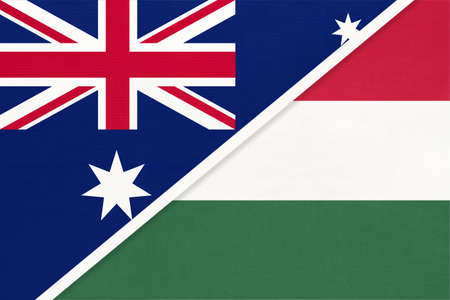 Australia and Hungary, national flags from textile. Relationship, partnership and match between two countries.