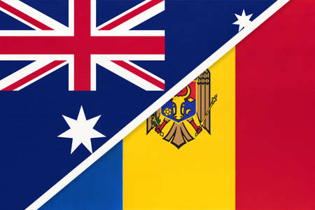 Australia and Moldova, national flags from textile. Relationship, partnership and match between two countries.