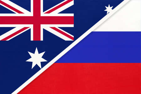 Australia and Russia or Russian Federation, national flags from textile. Relationship, partnership and match between two countries.