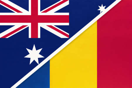 Australia and Romania, national flags from textile. Relationship, partnership and match between two countries. Standard-Bild