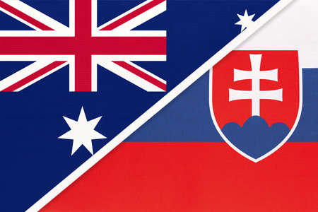 Australia and Slovakia or Slovak Republic, national flags from textile. Relationship, partnership and match between two countries.