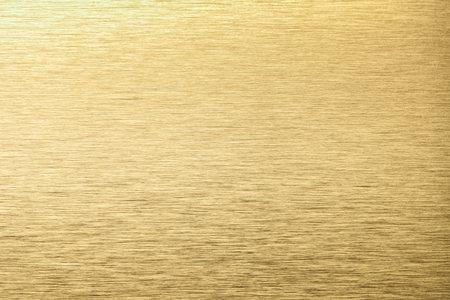 Light golden aluminum texture background. Yellow stainless steel texture metal backdrop.
