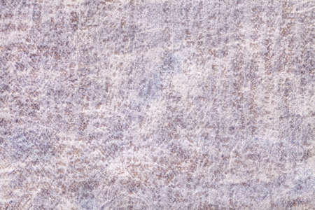 Light gray and pearl fluffy background of soft, fleecy fabric. Texture of ivory velveteen textile backdrop with shiny pattern, closeup. Standard-Bild
