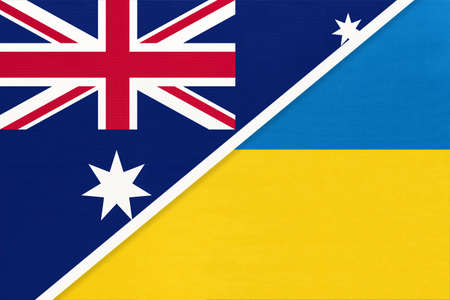 Australia and Ukraine, national flags from textile. Relationship, partnership and match between two countries.